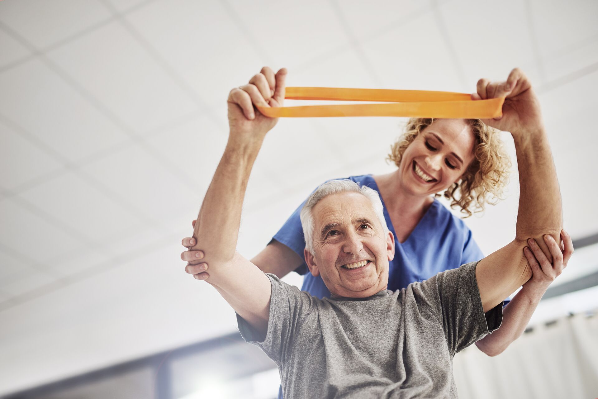 Senior man doing physical therapy exercises