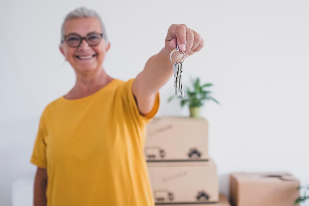 senior woman holding a set of keys
