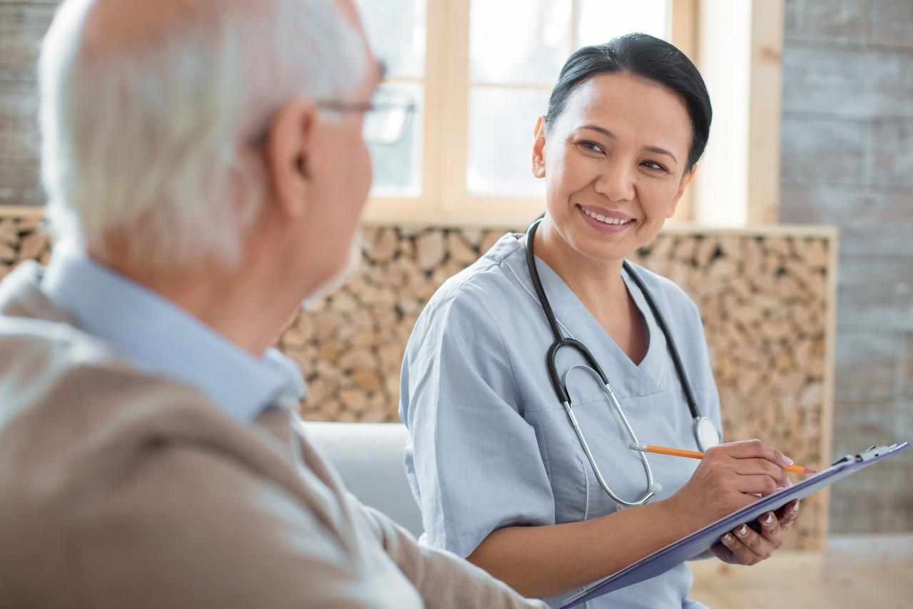 Nursing talking with an elderly gentleman
